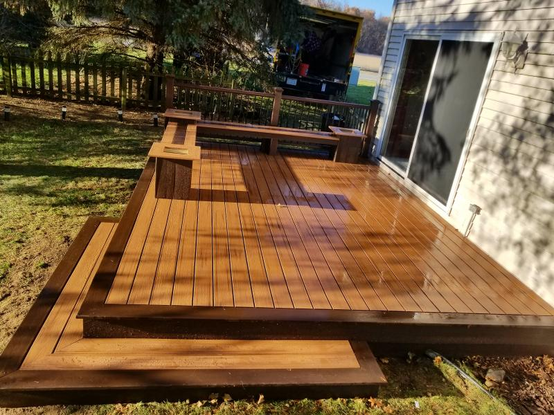 This Patio Deck With Tiki Torch Decking And Vintage Lantern Accent Includes A Wrap Around Bench Planters Double Corner Step